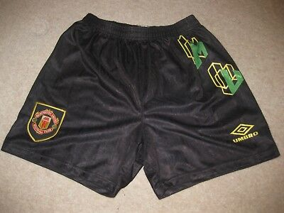 Black Manchester United shorts from Umbro green/gold kit. Boys - 30 inch waist