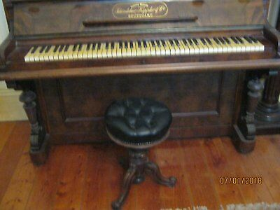 vintage piano and antique piano stool combination