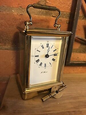 l'epee carriage clock Retailed By F . Hinds