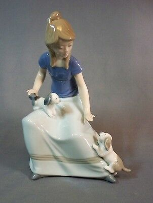 """Nao Figure Seated Young Girl With 2 Puppies 7"""" Tall"""