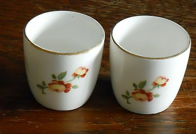 A pair of Crown Stafforshire Bone china egg cups