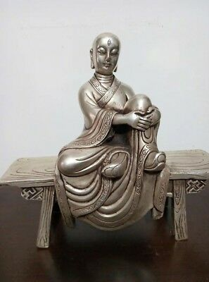 Collection White copper hand carved Buddha statue sitting on the stool