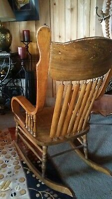 Antique Pressed Back Oak Rocking Chair with tall back