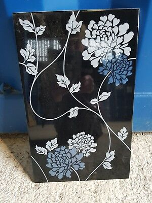 laura ashley designer ceramic tiles.  Black with white & blue flower.
