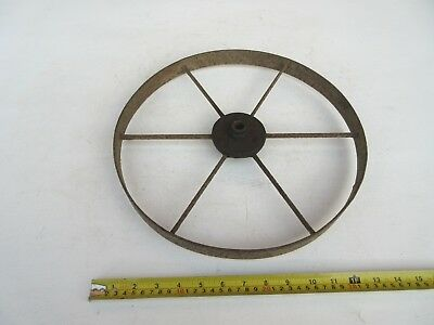 vintage industrial cast / forged? iron wheel .