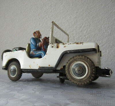 """9+""""  old Vintage Japan Tin Toy Police Jeep / automobile / car In a bad condition"""