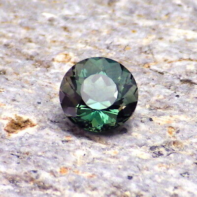 PEACOCK BLUE-TEAL OREGON SUNSTONE 0.69Ct FLAWLESS-VERY RARE COLOR-SMALL SIZED!
