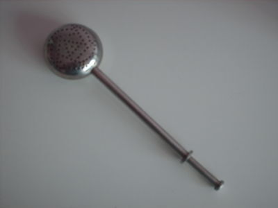 Early vintage spring lever tea strainer in top condition and full working order