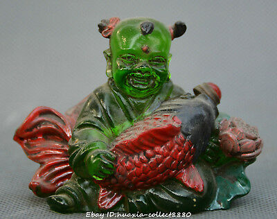 Chinese old coloured glaze hand carve boy Hold fish lotus flower snuff bottle