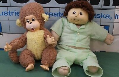 Lot of 2 stuff dolls, a baby monkey and regular baby