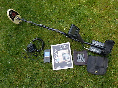 Whites DFX metal detector with headphones, covers & manual