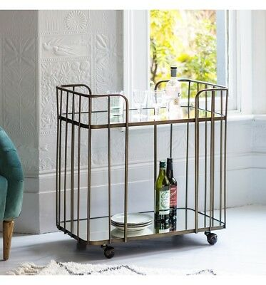 Drinks Trolley glass top and shelf with an art deco styled antique bronze frame
