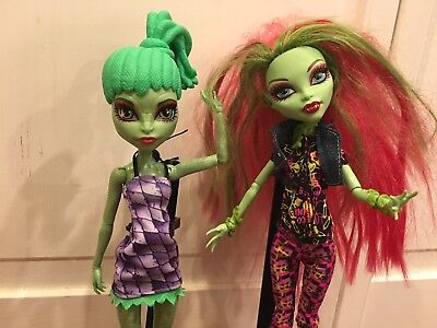 Two Monster High Dolls with accessories and holders