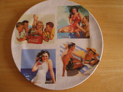 a set of 4 Coca-Cola plates decorated with vintage ads!