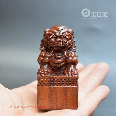 lovely! Hand-carved rosewood lion's shape