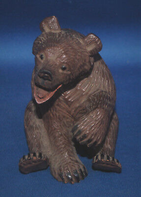A very well carved antique Victorian Black Forest sitting bear figure