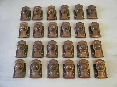 An ornate set of British made antique brass stair clips x 24