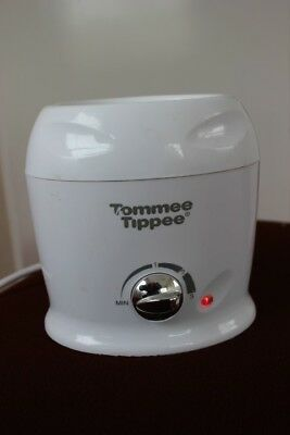 Tommee tippee baby bottle warmer. Fully working.  Milk home travel Electric