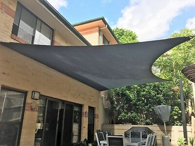 Patio shade sail with posts and railings