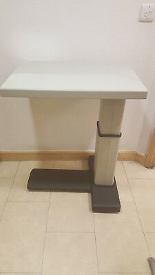 Ophthalmic electric instrument table