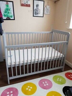 Pre-used baby's cot bed with mattress