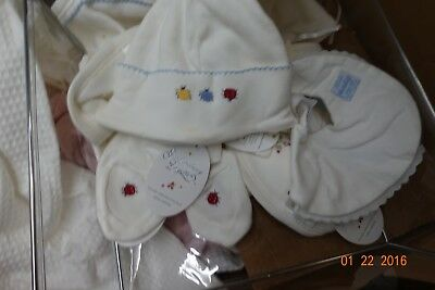 prox. 12 dresses / rompers 10 bib/ hat sets (estimate) include christening gown