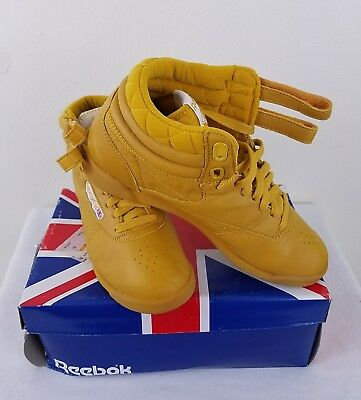 320f29b19df Reebok Vintage Freestyle Women s High Top Shoes Size 7.5 Varsity Gold!
