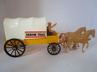 Oregon Trail Covered Wagon With Horses And Rider