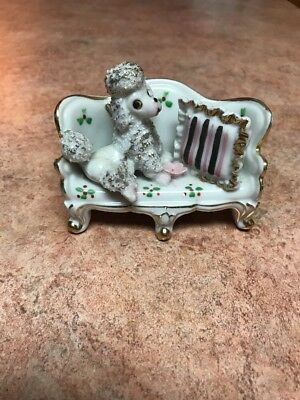 Vintage Porcelain Poodle Sitting On Her Settee  With A Pillow