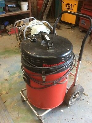 Numatic Industrial Vacuum Cleaner on wheels with several attachments and hose