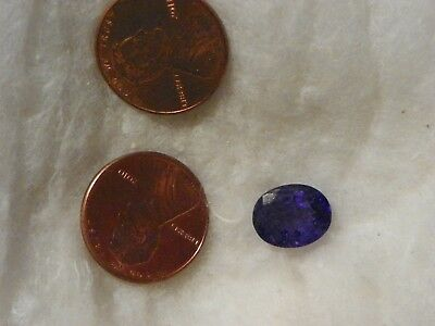 Tanzanite 4.45 Carats 9x11 MM. Oval Natural Inclusions Highly Flawed Blue Color