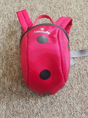 Little Life red ladybird backpack with reins and hood