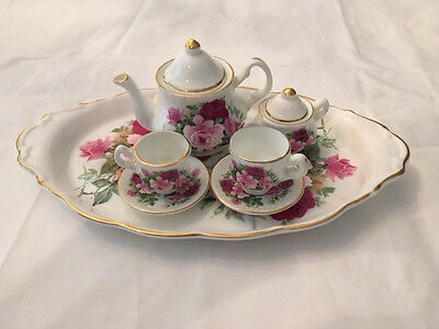 Miniature Tea Service Hand Painted by the Tom Cobblers Pottery Co.