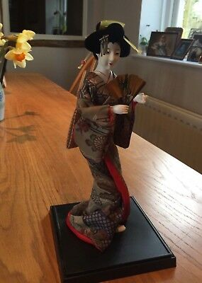 """Vintage 1990 12"""" tall Japanese Doll On A Stand, very good condition"""