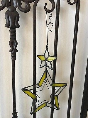 Unique Stained Glass Sun Catcher Yellow Star, with moving metal Star cutouts.