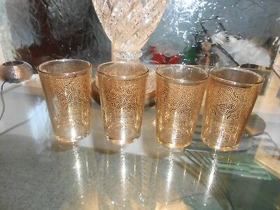 amber glasses x4 large 4in high with etched gold patternVG condition