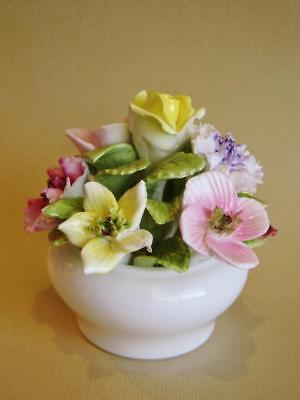 Vintage Coalport hand modelled and hand painted floral figurine, white pot.