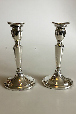 One pair of Silver Candlesticks. Marked H.J.