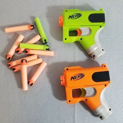 Pair of NERF N-strike Pistol Dart Tag Gun Sidearms lot Green Orange with Darts