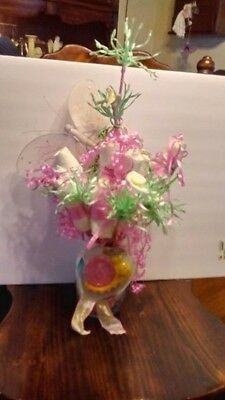 a beautiful diaper bouquet each diaper decorated with decorative ribbon