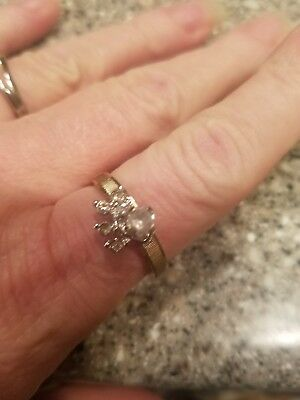 Vintage 14 kt H.G.E. signed Unas round clear stone with 4 smaller clear size 9