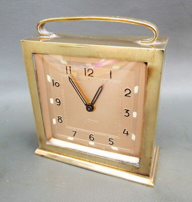 Vintage Japy alarm clock with brass case and pink dial