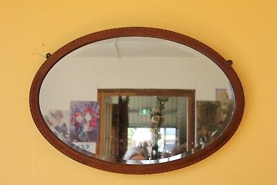 Large Edwardian Inlaid Oval Mirror.