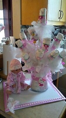 diaper cakes and bouquets pretty n pink