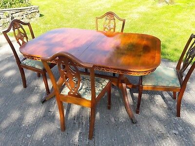 Yew Dining Table And Four Matching Chairs