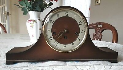 Vintage chiming wooden mantle clock with key. Made in Germany