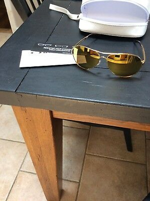 Oakley Womens Caveat Sunglasses!  Brand new, polished gold frames, gold lenses!