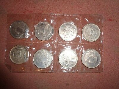 eight U.S. silver dollars