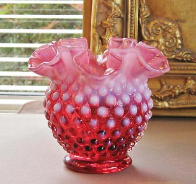 Fenton Cranberry hobnail glass vase with opalescent ruffle rim.