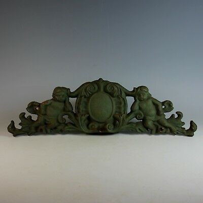 Vintage Cast Iron Overdoor Pediment with Putti and Shield